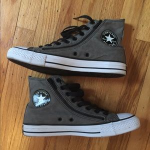 Hi top converse with zippers on sides.